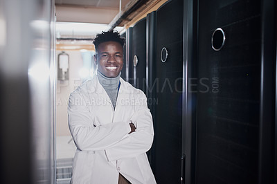 Buy stock photo Portrait of an attractive young man with folded arms at work in a server room