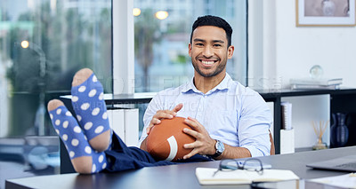 Buy stock photo Portrait of a young businessman holding a ball at his desk at work