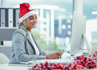 Buy stock photo Shot of a happy businesswoman on a video call at her desk at the office