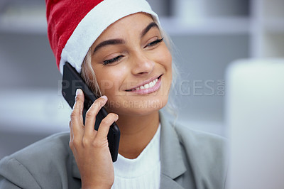 Buy stock photo Shot of a happy young woman enjoying a phone call at the office