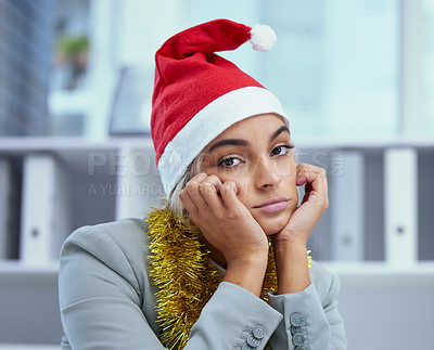 Buy stock photo Portrait of a sad young woman lost in thought at her desk in the office