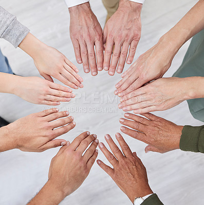 Buy stock photo Shot of a group of business people with their hands together in a circle