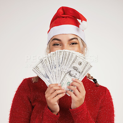 Buy stock photo Studio shot of a young woman posing with money against a grey background