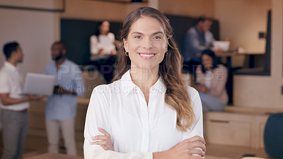 Buy stock photo Shot of an attractive young businesswoman standing in the office with her arms folded
