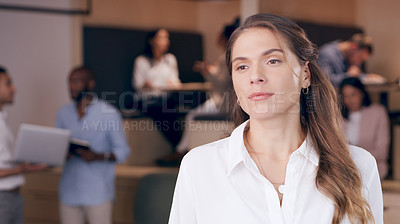Buy stock photo Shot of an attractive young businesswoman standing in the office and looking contemplative