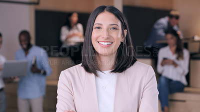 Buy stock photo Shot of an attractive young businesswoman standing in the office during the day