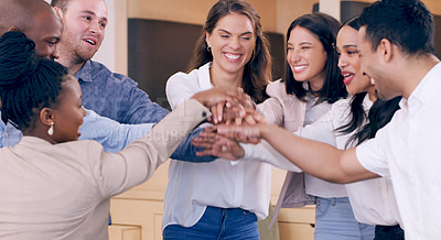 Buy stock photo Shot of a diverse group of businesspeople standing in the office and huddling together for a high five