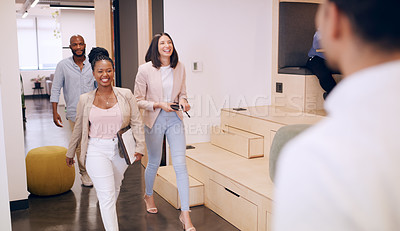 Buy stock photo Shot of a diverse group of businesspeople walking into the office together