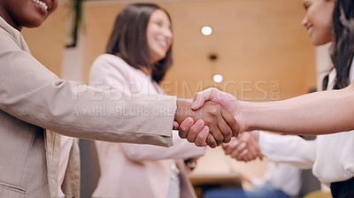 Buy stock photo Shot of an unrecognizable group of businesspeople standing in the office together and shaking hands during a discussion