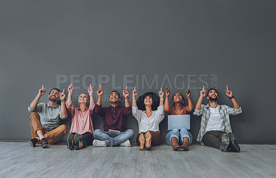Buy stock photo Studio shot of a diverse group of people pointing against a grey background