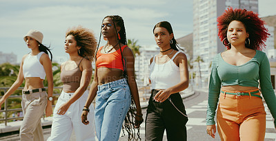 Buy stock photo Shot of a group of young girl friends in the city