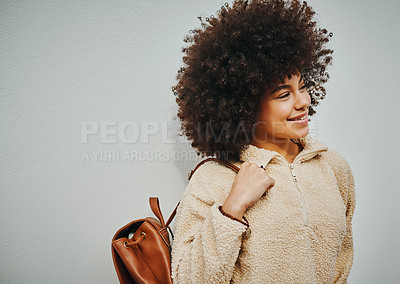 Buy stock photo Shot of a beautiful young woman out in the city