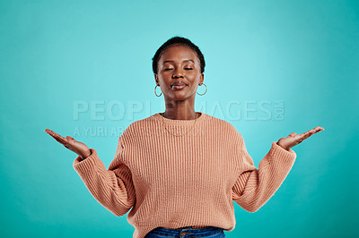 Buy stock photo Shot of a young woman holding up her hands and closing her eyes