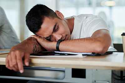 Buy stock photo Cropped shot of a handsome young businessman sleeping on the boardroom table