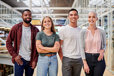 Buy stock photo Cropped portrait of a group of young businesspeople standing in the corridor of their creative office