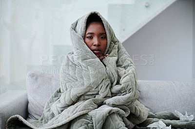 Buy stock photo Shot of a young woman with the flu sitting on the couch at home