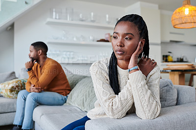 Buy stock photo Shot of a young woman looking upset after an argument with her partner at home