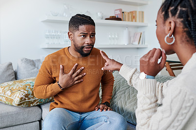 Buy stock photo Shot of a young couple having an argument at home
