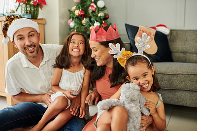 Buy stock photo Cropped portrait of an affectionate young family at home on Christmas eve