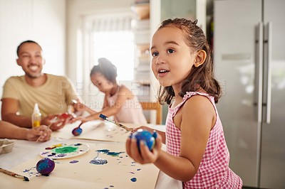 Buy stock photo Shot of a family painting eggs at home