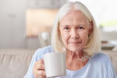Buy stock photo Portrait of a senior woman enjoying a cup of coffee at home