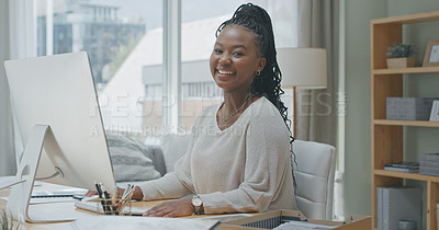 Buy stock photo Shot of a young woman using a computer while working from home