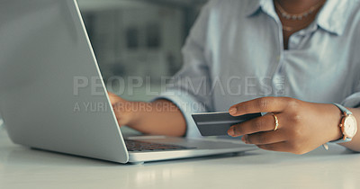 Buy stock photo Cropped shot of a young woman using her laptop to pay some of her bills in a modern office