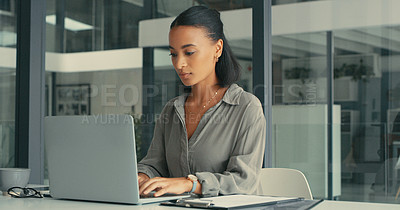 Buy stock photo Shot of a beautiful young woman using her laptop in a modern office