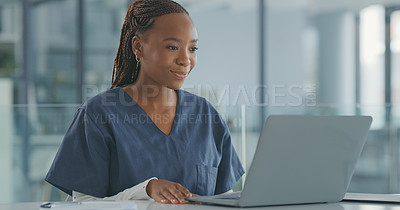 Buy stock photo Shot of a young female doctor using her laptop in her office