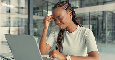 Buy stock photo Shot of a beautiful young woman suffering from a nasty migraine in a modern office