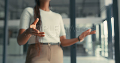 Buy stock photo Cropped shot of an unrecognizable woman making hands gestures while having a conversation in a modern office