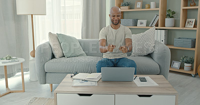Buy stock photo Shot of a young man using a laptop at home