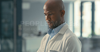Buy stock photo Shot of a male doctor at work in his office