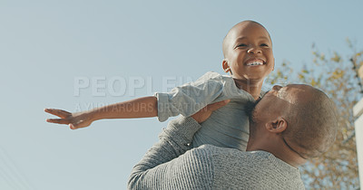 Buy stock photo Shot of a mature man and his grandson playing outside