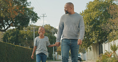 Buy stock photo Shot of a man taking his grandson for a walk outside