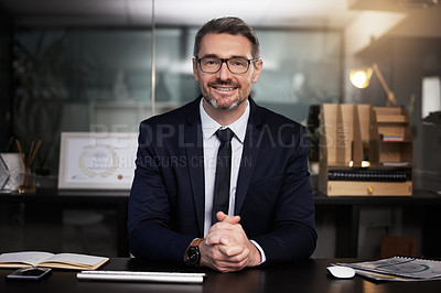 Buy stock photo Portrait of a mature businessman sitting at his desk