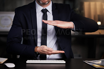 Buy stock photo Cropped shot of an unrecognisable businessman showing copyspace while sitting at his desk