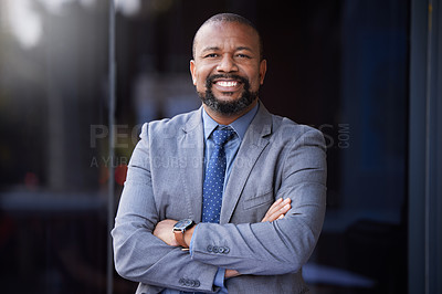 Buy stock photo Shot of a businessman wearing a suit while standing outside