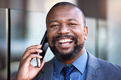 Buy stock photo Shot of a businessman talking on his cellphone while standing outside