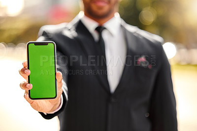 Buy stock photo Shot of a businessman holding his smartphone