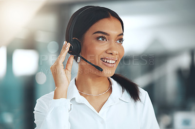 Buy stock photo Shot of a young call centre agent standing alone in her office