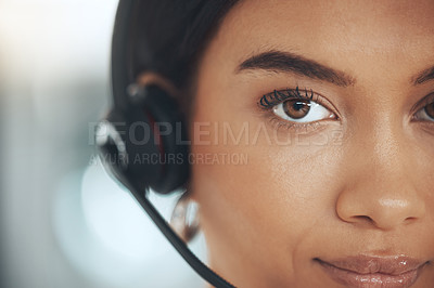 Buy stock photo Cropped shot of a young call centre agent sitting alone in her office