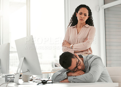 Buy stock photo Shot of a young male call center agent taking a nap at work