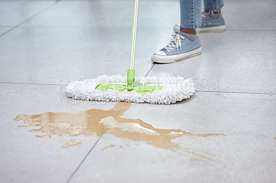 Buy stock photo Shot of a woman mopping her floor