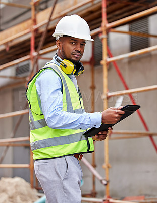 Buy stock photo Shot of a young man working on a construction site outside