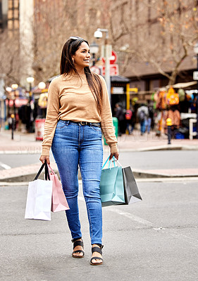 Buy stock photo Full length shot of an attractive young woman carrying a bunch of bags while shopping in the city