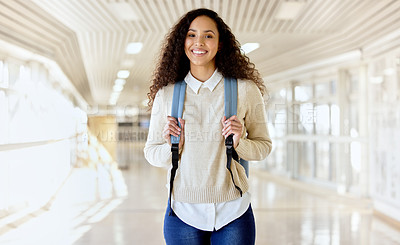 Buy stock photo Cropped portrait of an attractive young female college student standing with her backing in a campus hallway