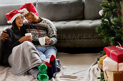 Buy stock photo Shot of a young couple sitting on the floor at home