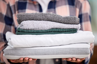 Buy stock photo Shot of an unrecognizable person holding freshly cleaned laundry