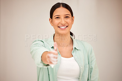 Buy stock photo Shot of a young woman showing a thumbs up against a white background